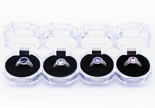 four rings and clear cases in product photography