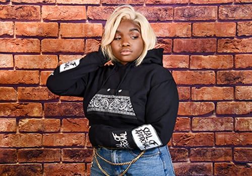 Young black woman wearing a Seal of Approval Hoodie for Product Modeling
