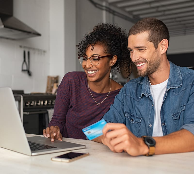 young couple purchasing online using a credit card