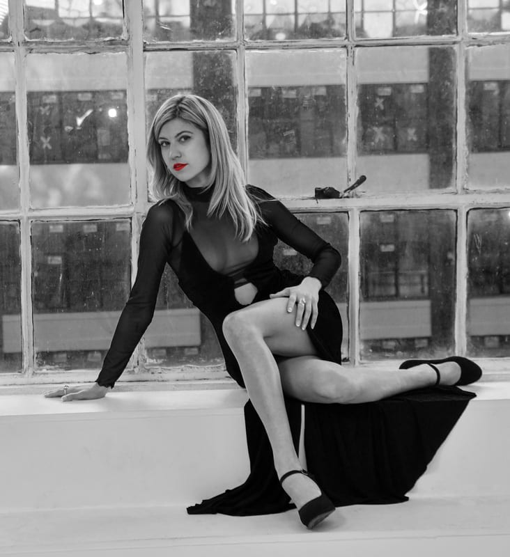 JoJo - Black and white photo of blonde model in front of window, with red lips