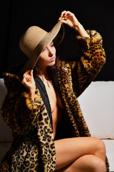 Kitti - Brunette model in leopard print jacket and hat