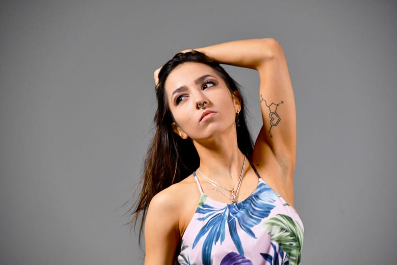 Kitti - Portrait of model on grey background