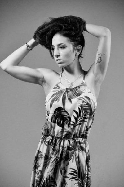 Kitti - Black and white photo of brunette model in floral dress