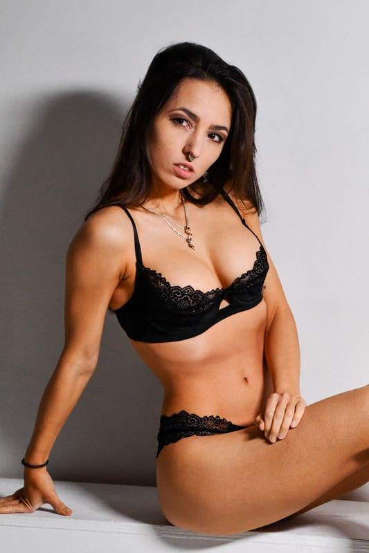 Kitti - Brunette model in black lingerie