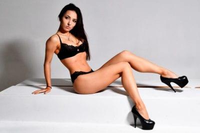 Kitti - brunette model in black lingerie and heels