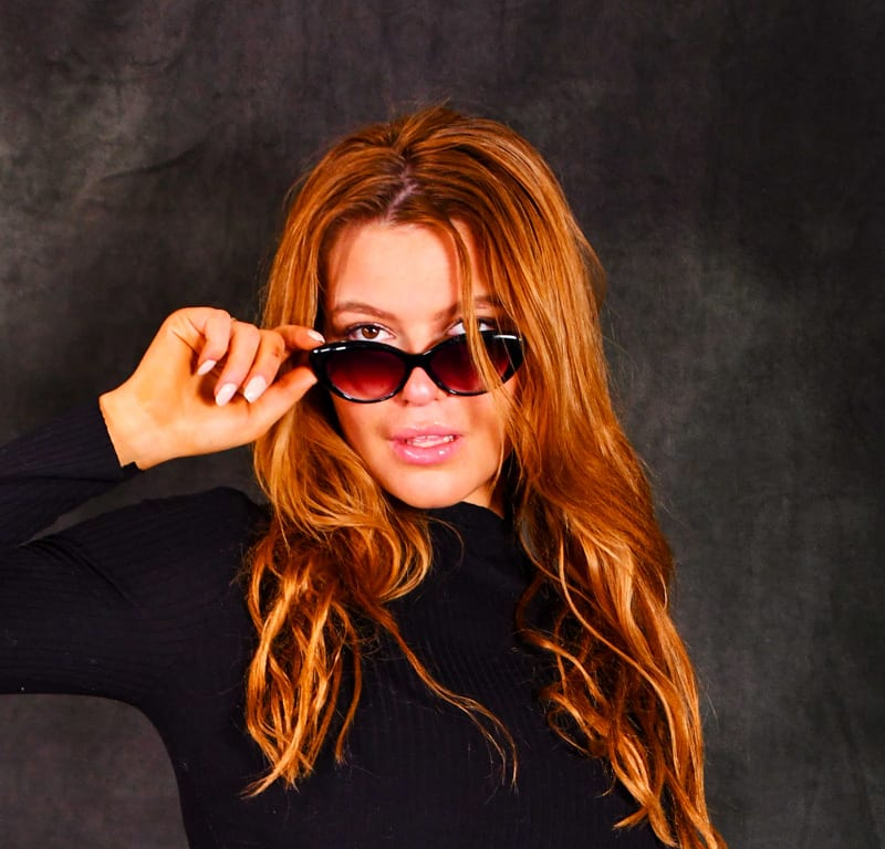Leah model - redhead with glasses