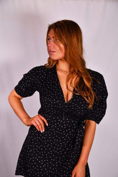 Leah Model, profile shot of redhead model in dark dress