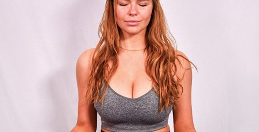 Leah models - redhead model in yoga pose, lotus position, meditations