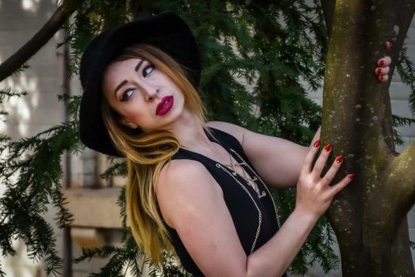 lydia, professional model against tree
