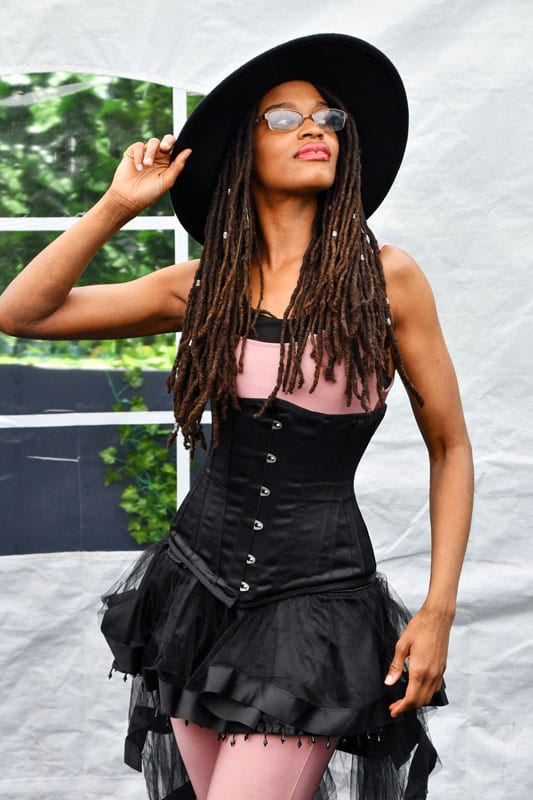 Theresee model in pink shirt and black corset