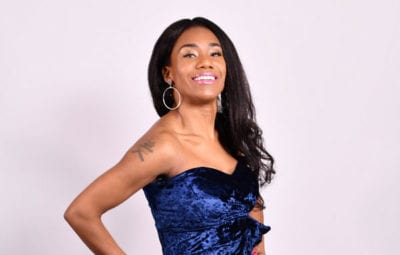 young woman in prom dress on white backdrop