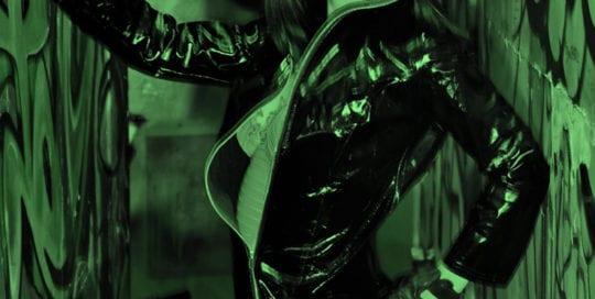 Aubrey - model in leather jacket under green light
