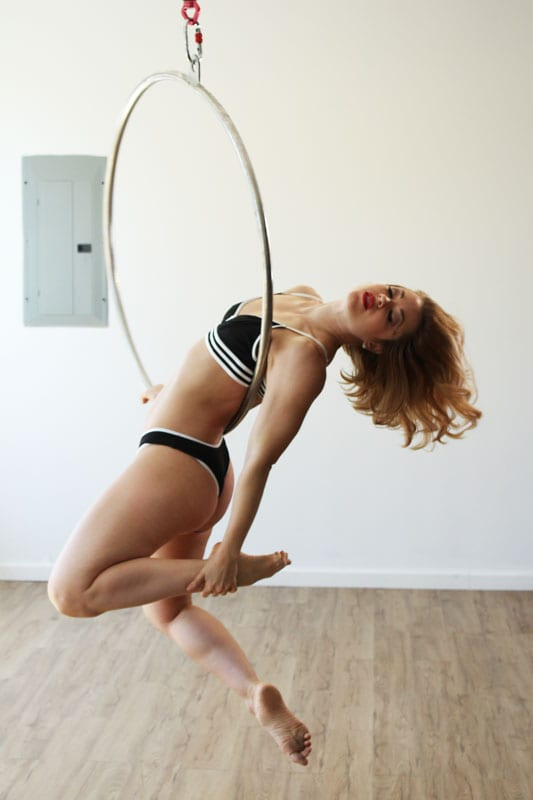 Rebecca - Blonde model on aerial ring in black athleticwear