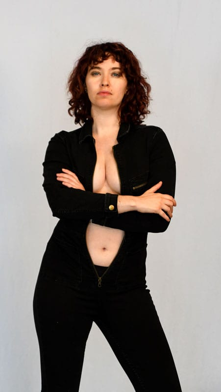 model Amanda - model with curly red hair in black on-piece outfit