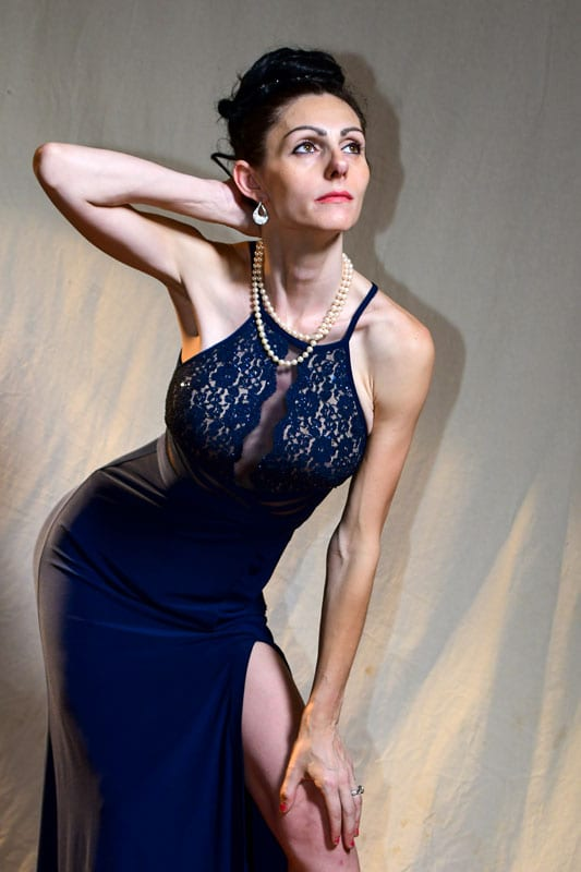 model - Abbie in blue dress with dramatic shadow