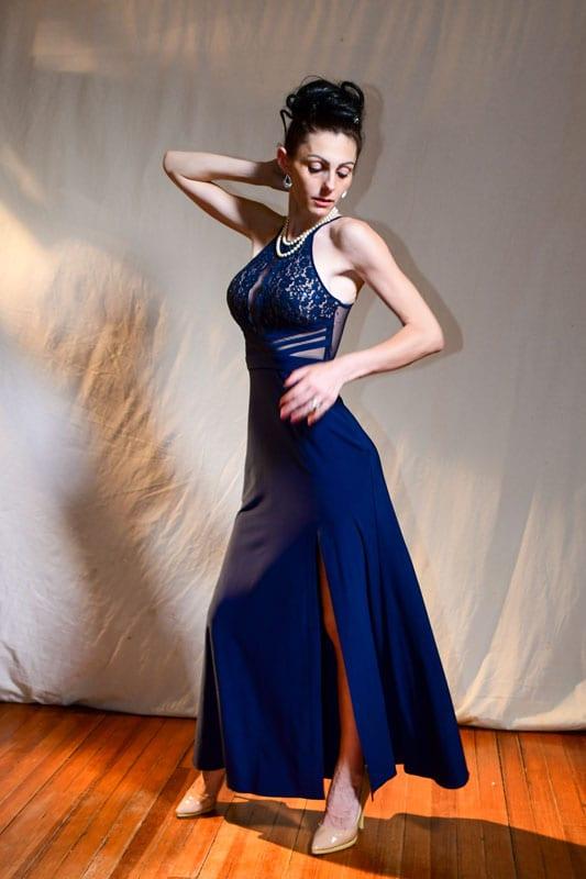 model abbie in blue dress looking down