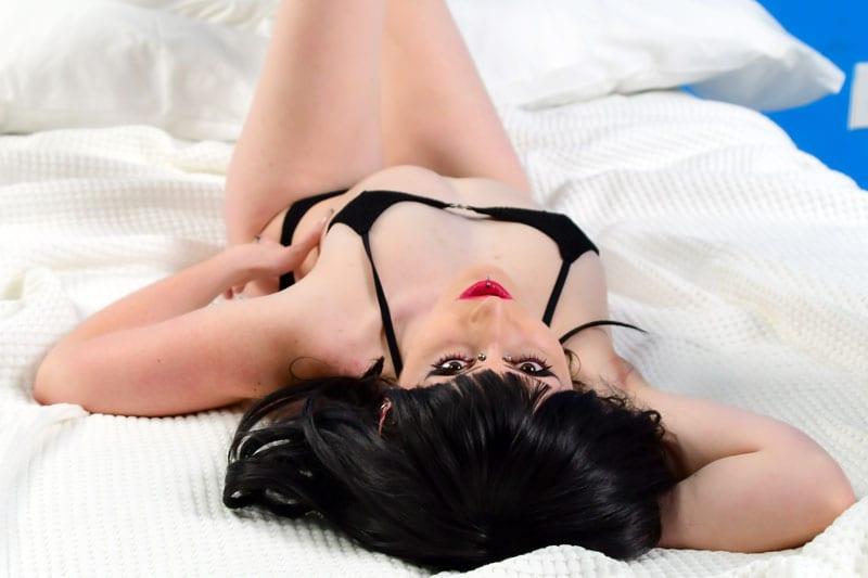 Jynx Alternative goth model laying on bed