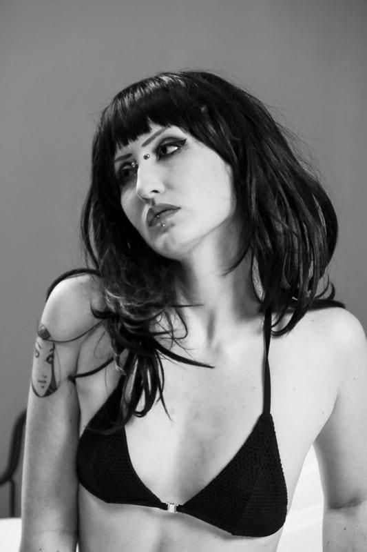 black and white image of alternative goth model bust shot