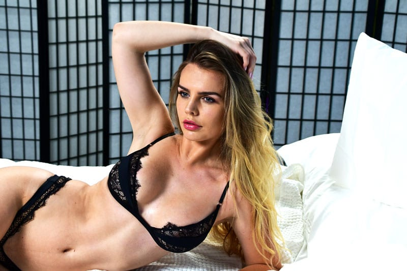 Katharine model in lingerie lounging on bed