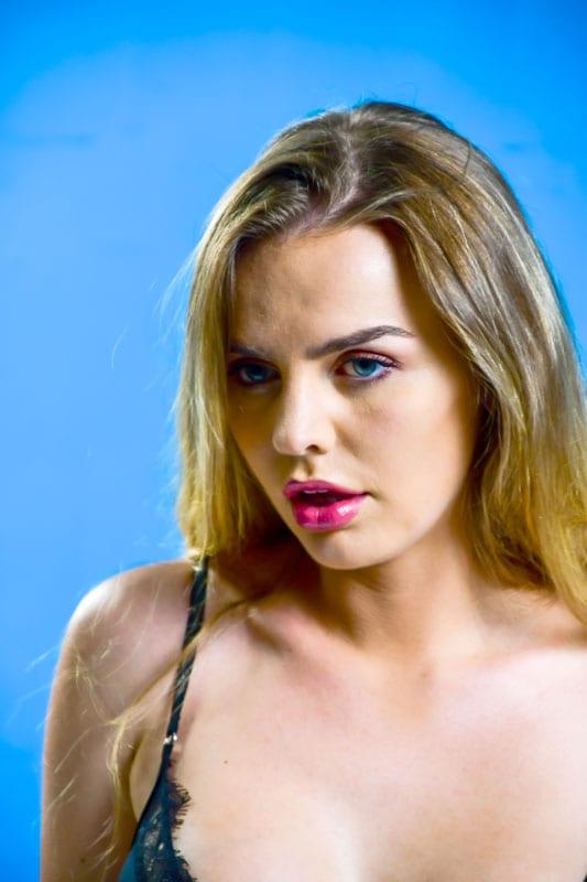 Katharine - blonde model headshot with blue backdrop