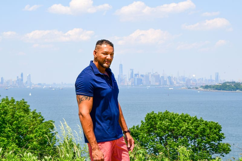 Male model Olivier with NYC cityscape behind.