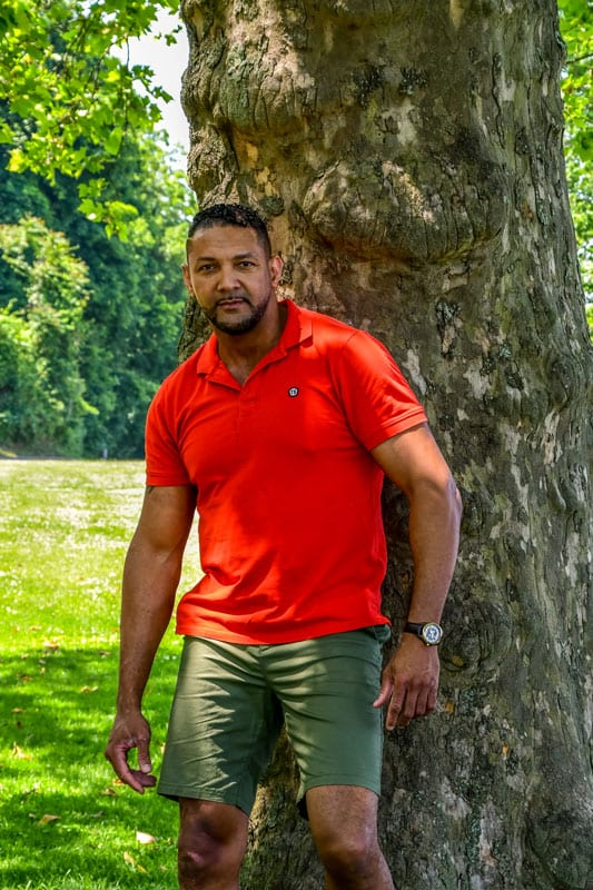 male model Olivier in red polo under tree