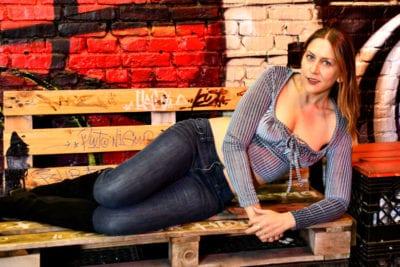 Erica model near red and black graffiti